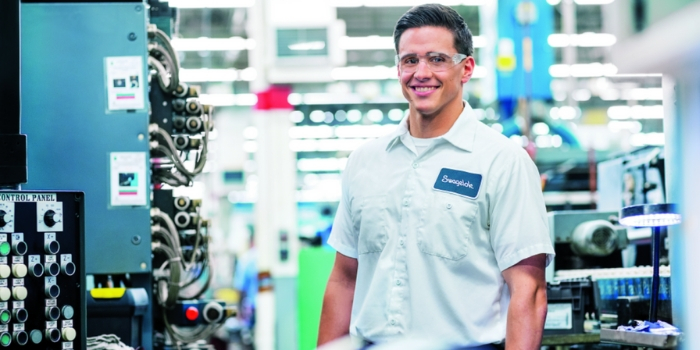 Associate on shop floor smiling male