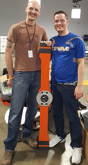 Swagelok Northern California's Neil Ide (left) with Team Icewave and battlebot