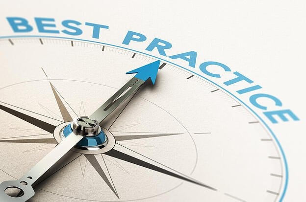 Compass with a needle pointing to best practice